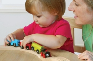 young_child_playing_with_toy_train (2)