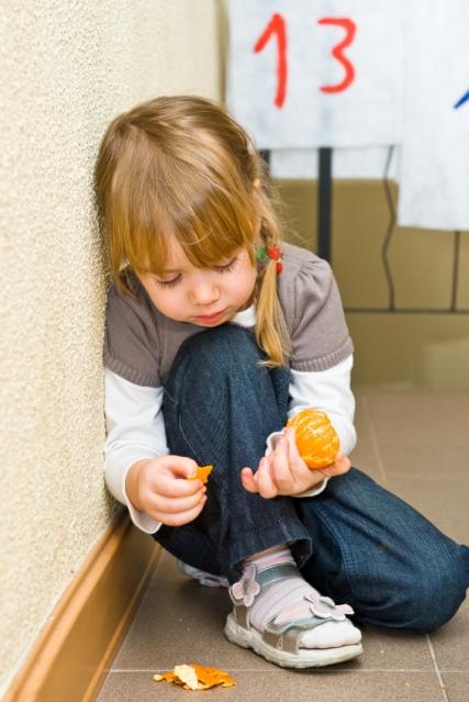 iStock_000012519580 Little Girl eating orange
