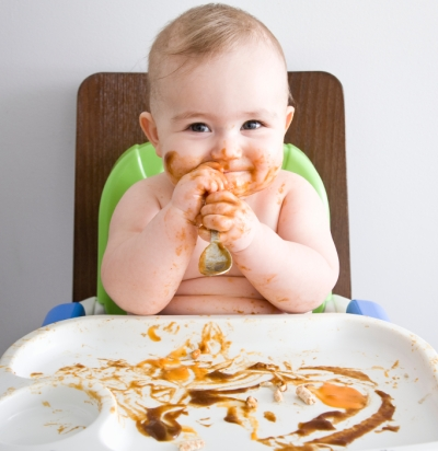 Messy eating baby