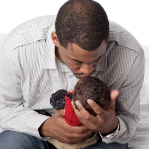 Father kissing baby boy