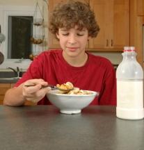 teen eating breakfast