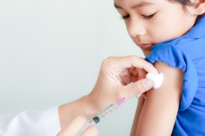 Boy and vaccine syringe
