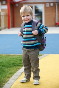 Little Boy Going To School Wearing Backpack