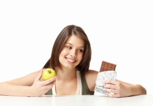 Teenage Girl Choosing Between Healthy and Unhealthy Eating