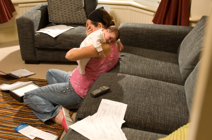 Overwhelmed mother with baby