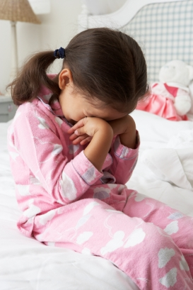 Tired Young Girl Wearing Pajamas at Bedtime