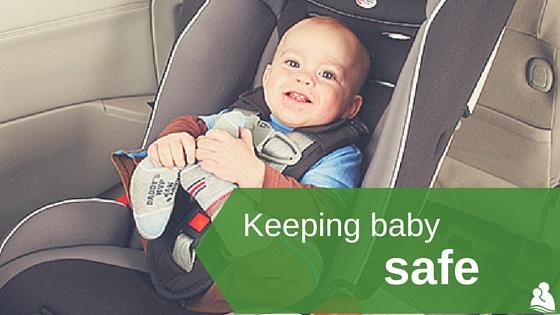 Keeping baby safe: baby smiling in car seat