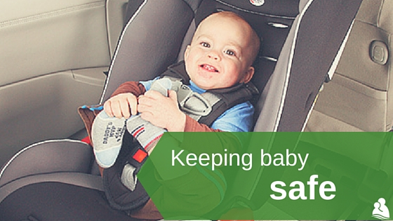 Keeping baby safe: baby smiling in car seat