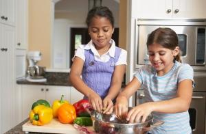 Mixed Race sisters preparing food