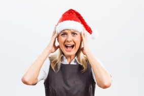 Business woman with Santa Hat is in panic because of something.