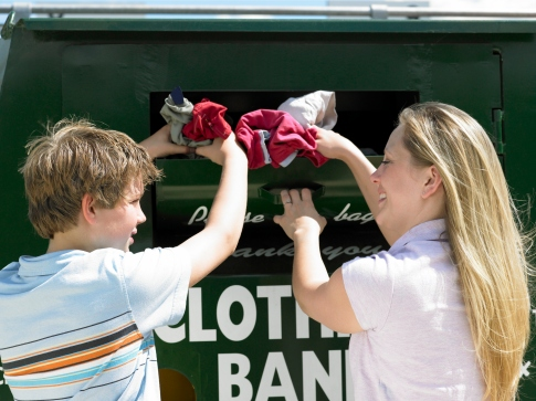 Woman and boy donating clothing