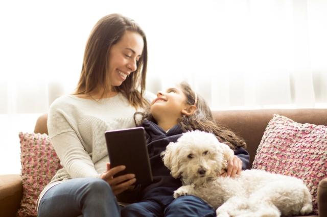 Mother, daughter and dog relaxed at home