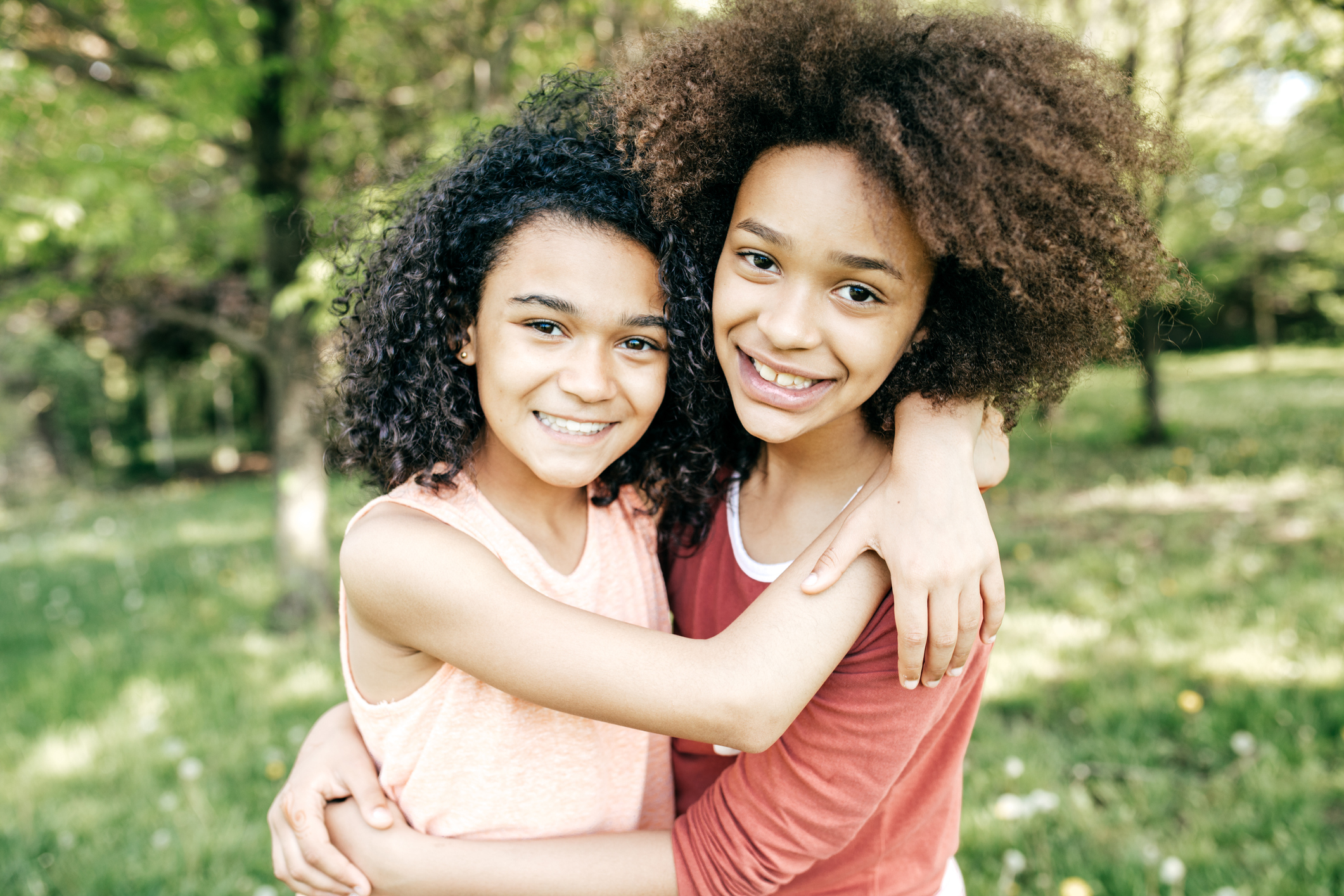 Two sisters hugging ages 9 and 11